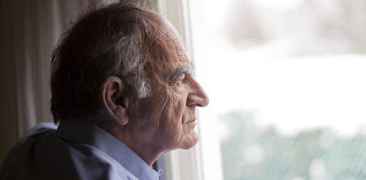 Old Man Looking Out Window - Massachusetts Xarelto Lawsuit