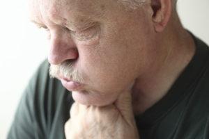 Man suffering heartburn   Nevada Nexium Lawsuit
