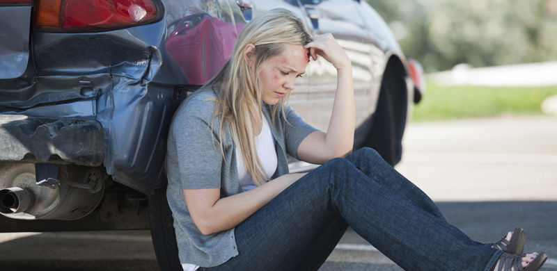 Woman Next to Car | Nevada Auto Accident Lawyer
