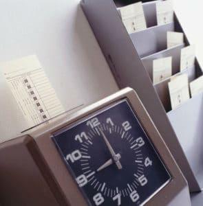 Clocking in machine   Washington Unpaid Overtime Lawsuit
