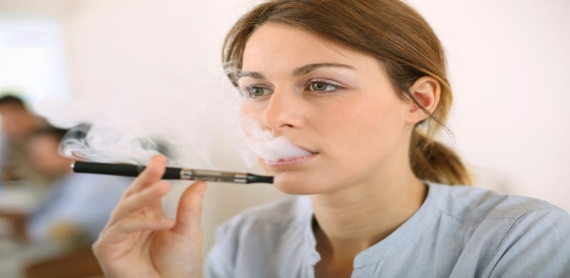 Woman Smoking An E-Cig | E-Cigarette Lawsuit