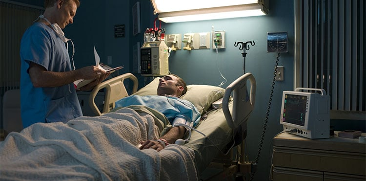 Man in hospital bed | Endoscope Cleaning Device Lawsuit