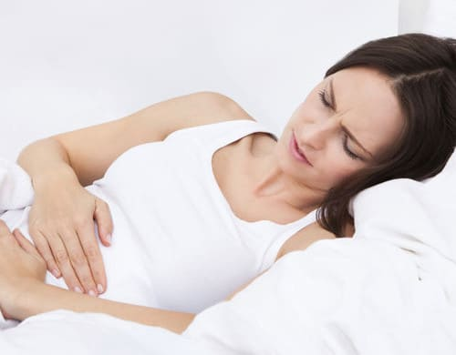 Woman Holding Her Stomach | Transvaginal Mesh Attorney