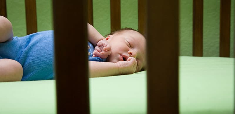 Baby Sleeping In A Crib | Mattress Pad Suffocation Lawsuit