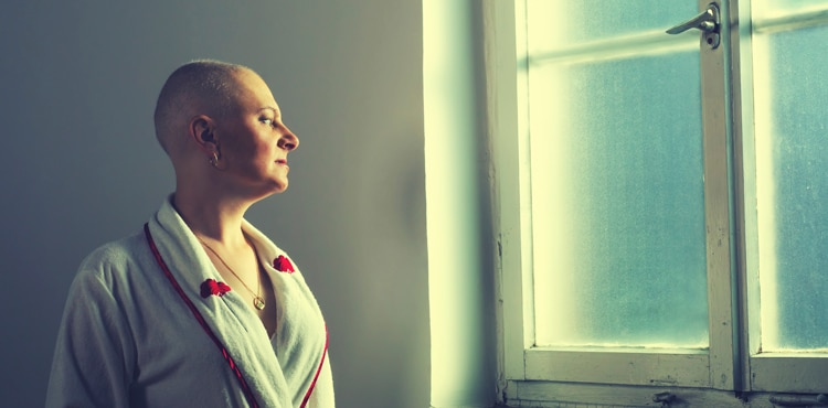Woman Looking Out Window | Taxotere Lawsuit
