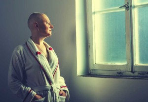 Bald Woman Looking Out a Window | Oklahoma Taxotere Hair Loss Lawsuit