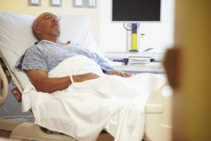 Man in a hospital bed | Kansas Viagra Melanoma Cancer Lawsuit